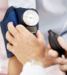blood pressure cuff on cancer patient